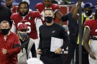 Arizona Cardinals head coach Kliff Kingsbury, center in black, jogs onto the field after their 38-10 win against the Dallas Cowboys in an NFL football game in Arlington, Texas, Monday, Oct. 19, 2020. (AP Photo/Ron Jenkins)