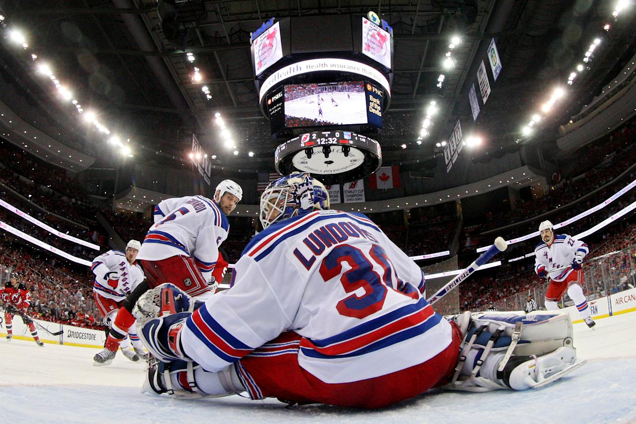 NEWARK, NJ - MAY 25:  Henrik Lundqvist #30 of the New York Rangers makes a save against the New Jersey Devils in Game Six of the Eastern Conference Final during the 2012 NHL Stanley Cup Playoffs at the Prudential Center on May 25, 2012 in Newark, New Jersey.  (Photo by Jim McIsaac/Getty Images)