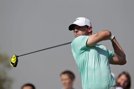 Rory McIlroy of Northern Ireland watches his shot from the second tee during the final round of the DP World Tour Championship in Dubai November 23, 2014. REUTERS/Nikhil Monteiro