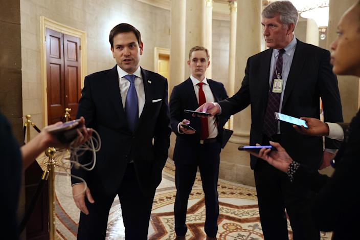Sen. Marco Rubio (R-FL) talks to reporters after leaving a meeting with fellow Republican senators and Treasury Secretary Steven Mnuchin during negotiations on a $2 trillion economic stimulus. (Chip Somodevilla/Getty Images)