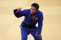 Naohisa Takato, of Japan, celebrates after defeating Yang Yung-wei, of Taiwan, in a men's 60-kg judo gold medal match at the 2020 Summer Olympics, Saturday, July 24, 2021, in Tokyo. (AP Photo/Jae C. Hong)