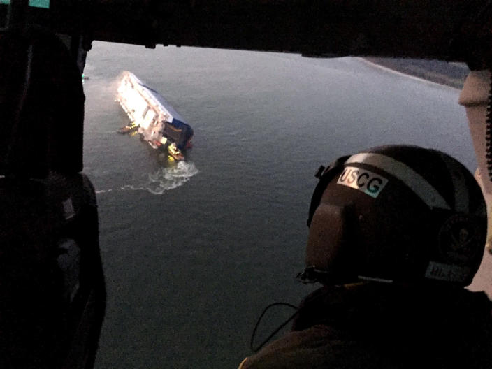 Coast Guard crews and port partners respond to a disabled cargo vessel with a fire on board Sunday, Sept. 8, 2019, in St. Simons Sound, Ga. (U.S. Coast Guard via AP)