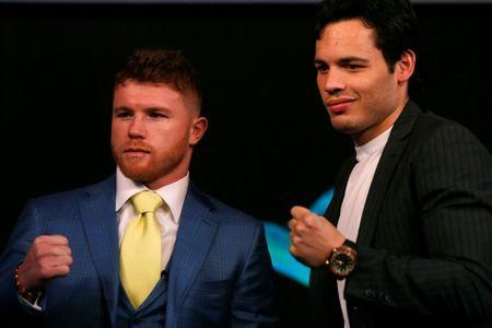 Mexico's boxers Canelo Alvarez, (L), and Julio Cesar Chavez, Jr (R), pose for a photograph during a news conference ahead of WBC brawl in Las Vegas, in Mexico City, Mexico, February 20, 2017. REUTERS/Carlos Jasso