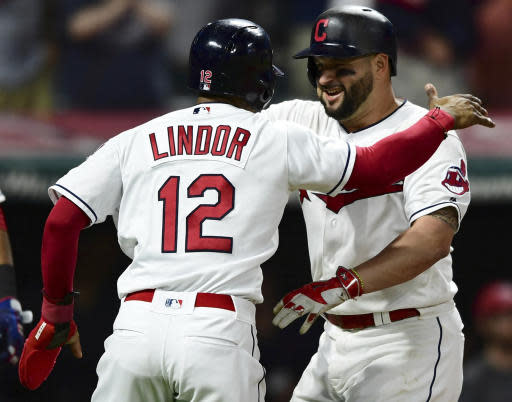 Cleveland Indians' Yonder Alonso, right, is congratulated by Francisco Lindor after hitting a grand slam off Detroit Tigers relief pitcher Johnny Barbato during the seventh inning of a baseball game Friday, June 22, 2018, in Cleveland. (AP Photo/David Dermer)