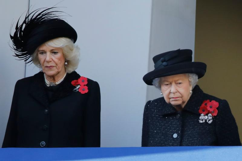 Britain's Camilla, Duchess of Cornwall (L) and Britain's Queen Elizabeth II (R) watch from a balcony as they attend the Remembrance Sunday ceremony at the Cenotaph on Whitehall in central London, on November 10, 2019. - Remembrance Sunday is an annual commemoration held on the closest Sunday to Armistice Day, November 11, the anniversary of the end of the First World War and services across Commonwealth countries remember servicemen and women who have fallen in the line of duty since WWI. (Photo by Tolga AKMEN / AFP) (Photo by TOLGA AKMEN/AFP via Getty Images)