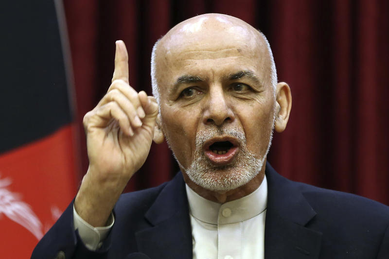 FILE - In this March, 1, 2020 file photo, Afghan President Ashraf Ghani speaks during a news conference at the presidential palace in Kabul, Afghanistan. Ghani and political rival Abdullah Abdullah have signed a power-sharing agreement eight months after both declared themselves the winner of last September's presidential election, a spokesman for Ghani said Sunday, May 17, 2020. Sediq Sediqqi tweeted Sunday that a political deal between Ghani and Abdullah had been signed in which Ghani would remain president of the war-torn nation and Abdullah would lead the country's National Reconciliation High Council. (AP Photo/Rahmat Gul, File)