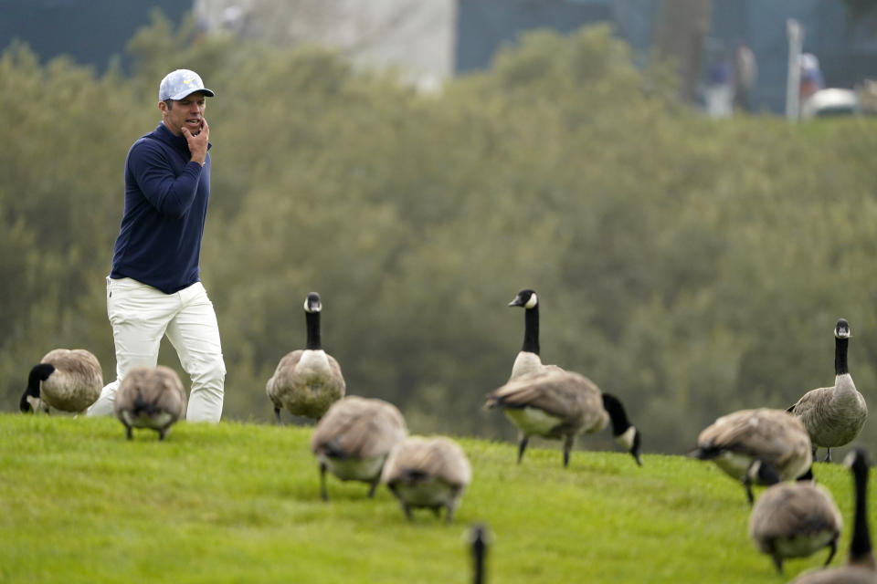 Paul Casey walks past a flock of geese on the 18th hole during the third round of the PGA Championship golf tournament at TPC Harding Park Saturday, Aug. 8, 2020, in San Francisco. (AP Photo/Charlie Riedel)
