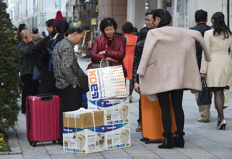 Chinese tourists spent more than $164 billion in 2014, according to a report by Bank of America Merrill Lynch (AFP Photo/Toru Yamanaka)