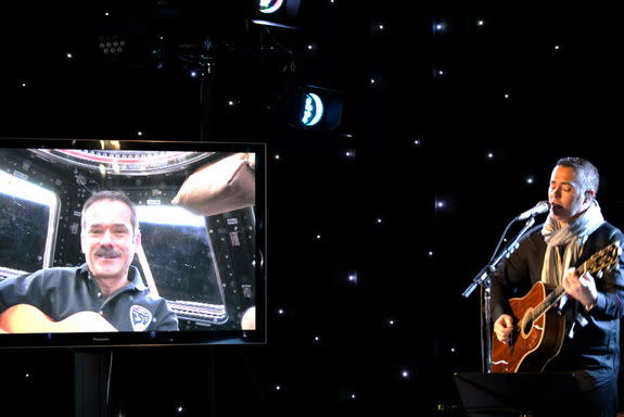 Chris Hadfield (left) performed from the International Space Station's cupola, while Barenaked Ladies singer Ed Robertson (right) sang with his bandmates and a youth choir in Toronto, Canada.