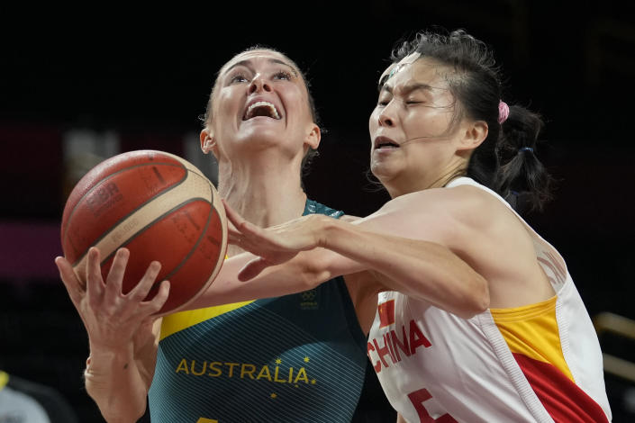 Australia's Katie Ebzery, left, is fouled by China's Siyu Wang, right, during a women's basketball preliminary round game at the 2020 Summer Olympics in Saitama, Japan, Friday, July 30, 2021. (AP Photo/Eric Gay)