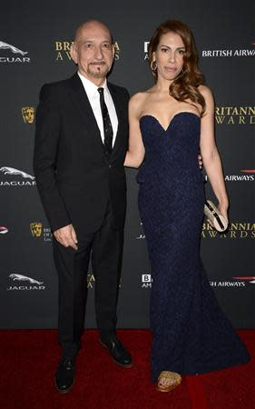 Actors Ben Kingsley (L) and Daniela Lavender attend the BAFTA Los Angeles Britannia Awards in Beverly Hills, California November 9, 2013. REUTERS/Phil McCarten