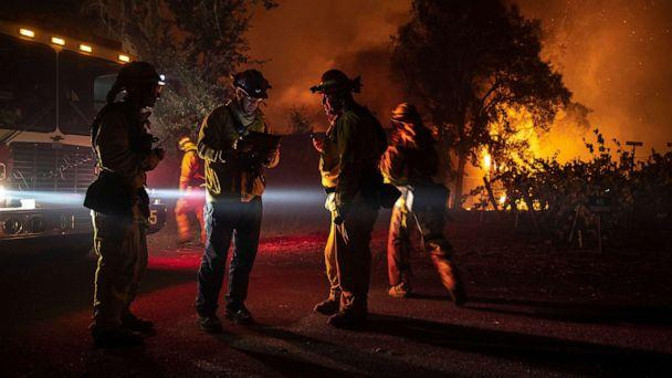 PHOTO: Firefighters plan their move as a building burns out of control, as the Kincade Fire continues to burn in Healdsburg, Calif., Oct. 27, 2019. (Peter Dasilva/EPA via Shutterstock)