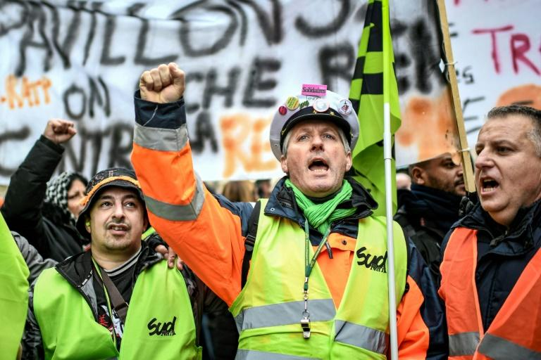Strikers at a demonstration near Gare de l'Est train station in Paris on December 26. The reasons for strikes, analysts say, are multiple and complex, and touch on the French republic's revolutionary origins, its educational philosophy, union traditions and even the electoral system
