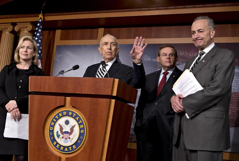 Northeast lawmakers react after the Senate passed a $50.5 billion emergency relief measure for Superstorm Sandy victims at the Capitol in Washington, Monday, Jan. 28, 2013. From right to left are Sen. Charles Schumer, D-N.Y., Sen. Robert Menendez, D-N.J., Sen. Frank Lautenberg, D-N.J., and Sen. Kirsten Gillibrand, D-N.Y. Three months after Superstorm Sandy devastated coastal areas in much of the Northeast, the Senate is finally sending a $50.5 billion emergency package of relief and recovery aid to President Obama for his signature. (AP Photo/J. Scott Applewhite)
