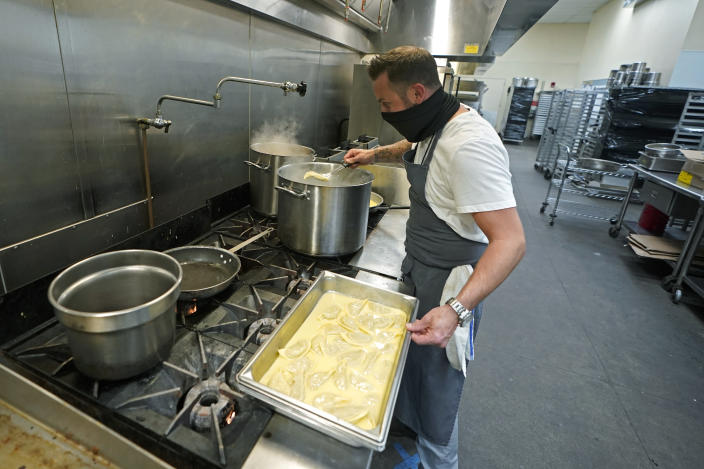 "Joel Handshuh, executive chef at The Lakehouse, a restaurant located in Bellevue, Wash., prepares hand-filled Chanterelle mushroom pasta as he works in the kitchen at Lumen Field, Thursday, Feb. 18, 2021, in Seattle. Handshuh was one of the chefs taking part in the inaugural night of the ""Field To Table"" event at stadium, which is home to the Seattle Seahawks NFL football team. The event will feature several weeks of dates that offer four-course meals cooked by local chefs and served at tables socially distanced as a precaution against the COVID-19 pandemic. (AP Photo/Ted S. Warren)"