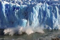 FILE PHOTO: Splinters of ice peel off from one of the sides of the Perito Moreno glacier in Splinters of ice peel off from one of the sides of the Perito Moreno glacier in southern Argentina