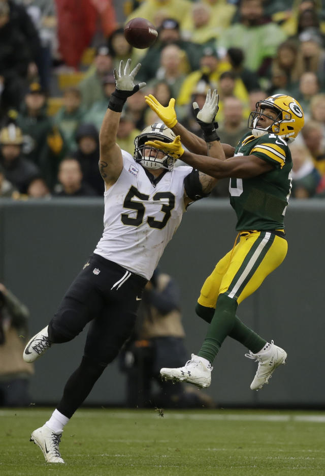 <p>New Orleans Saints outside linebacker A.J. Klein (53) breaks up a pass intended for Green Bay Packers wide receiver Randall Cobb (18) during the second half of an NFL football game, Sunday, Oct. 22, 2017, in Green Bay, Wis. (AP Photo/Jeffrey Phelps) </p>