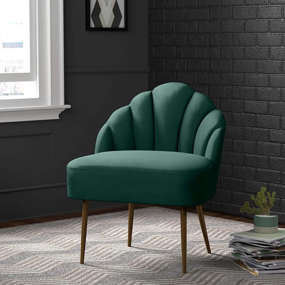 """<p>Here at POPSUGAR, we are fans of <a href=""""https://www.popsugar.com/home/Velvet-Furniture-Amazon-45749973"""" class=""""link rapid-noclick-resp"""" rel=""""nofollow noopener"""" target=""""_blank"""" data-ylk=""""slk:velvet furniture"""">velvet furniture</a>. The rich texture and glam look are two of the reasons we added this <span>Rivet Sheena Glam Tufted Velvet Shell Chair</span> ($170) to our list of favorites.</p>"""