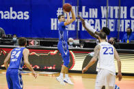 Creighton's Marcus Zegarowski (11) shoots a three point basket over Seton Hall's Myles Cale and Sandro Mamukelashvili (23) to take the lead during the second half of an NCAA college basketball game Wednesday, Jan. 27, 2021, in Newark, N.J. Creighton won 85-81. (AP Photo/Frank Franklin II)