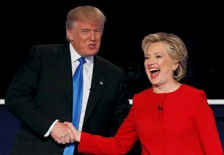 Republican U.S. presidential nominee Donald Trump shakes hands with Democratic U.S. presidential nominee Hillary Clinton at the conclusion of their first presidential debate at Hofstra University in Hempstead