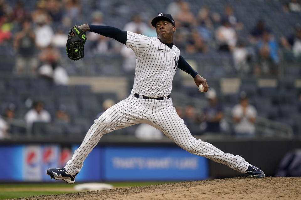New York Yankees relief pitcher Aroldis Chapman throws in the ninth inning of a baseball game against the Oakland Athletics, Saturday, June 19, 2021, in New York. (AP Photo/John Minchillo)