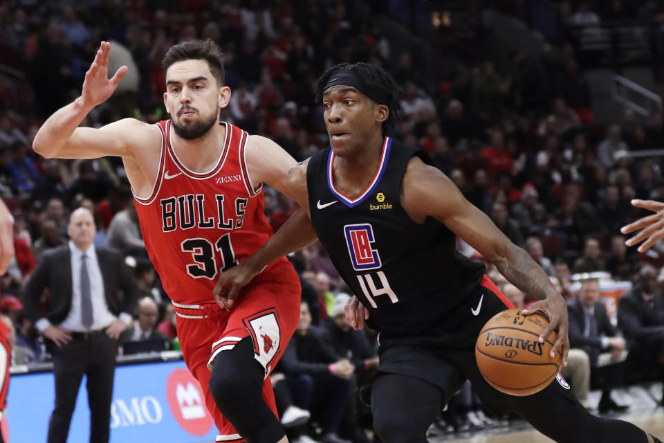 Los Angeles Clippers guard Terence Mann, right, drives to the basket as Chicago Bulls guard Tomas Satoransky defends during the first half of an NBA basketball game Saturday, Dec. 14, 2019, in Chicago. (AP Photo/Nam Y. Huh)
