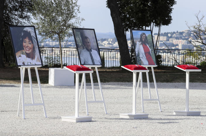 The portraits of, from the left, victims Nadine Devillers, Vincent Loques and Brazil's Simone Barreto Silva are pictured in Nice, southern France, Saturday Nov. 7, 2020, during a ceremony in homage to the three victims of an attack at Notre-Dame de Nice Basilica on October 29, 2020. Three people were killed in an Islamic extremist attack at Notre Dame Basilica in the city of Nice that pushed the country into high security alert. (Valery Hache; Pool via AP)