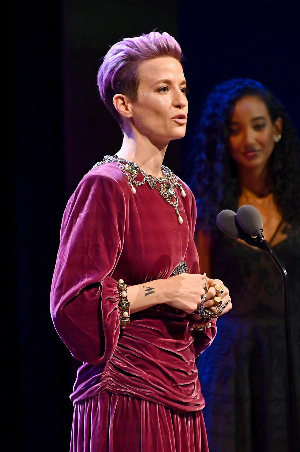 """<p>Possibly Rapinoe's most easily spotted tattoo is the large """"W"""" on her right wrist. Her sister, Jennifer Brooks, told <strong>Harpers Bazaar</strong>, """"The line of the women in our family, we're warriors. That 'W' on her wrist is for 'Warrior Woman.' We're just driven, and Megan has always been overdriven.""""</p>"""