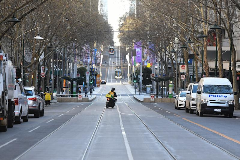 A delivery driver is seen on Bourke Street in Melbourne, Sunday, September 6, 2020. Victorian Premier Daniel Andrews has confirmed some COVID-19 restrictions will soon be eased but Melbourne's curfew will remain until at least October 26.