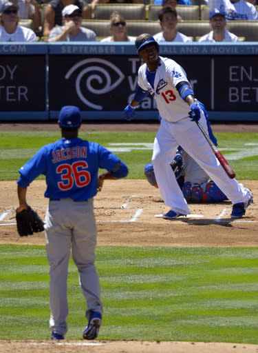 Los Angeles Dodgers' Hanley Ramirez (13), right, watches the ball go for a solo home run as Chicago Cubs starting pitcher Edwin Jackson (36) looks on during the first inning of their baseball game on Wednesday, Aug. 28, 2013, in Los Angeles. (AP Photo/Mark J. Terrill)