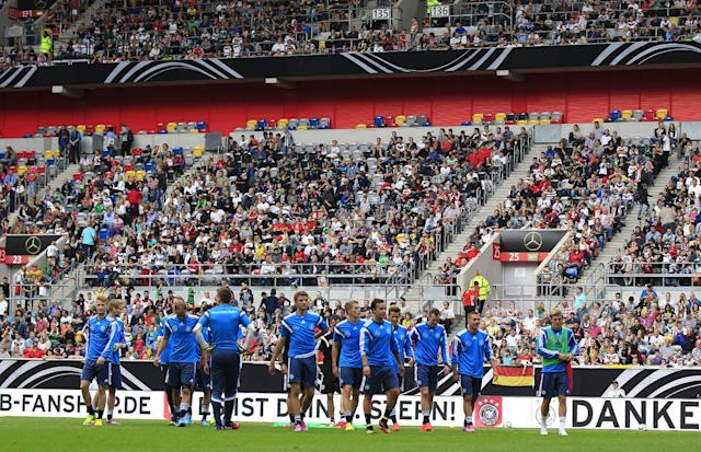Geman players take a break during an open training session ahead of the friendly soccer match between Germany and Argentina on Wednesday in Duesseldorf, Germany, Monday, Sept. 1, 2014. (AP Photo/Frank Augstein)