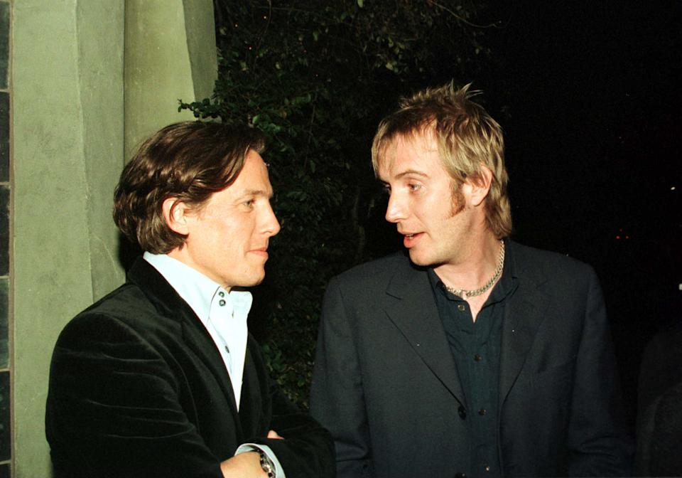 01/22/00. Beverly Hills, Ca. Hugh Grant Shares A Moment With Rhys Ifans Who Played His Room-Mate Spike, In The Hit Movie