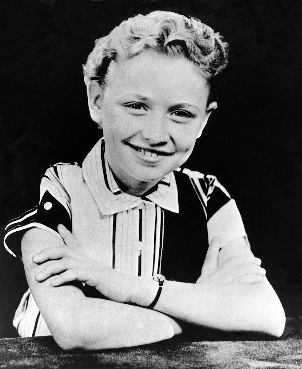 <p>Parton, one of 12 children, poses for a portrait in Tennessee at nine years old.</p>