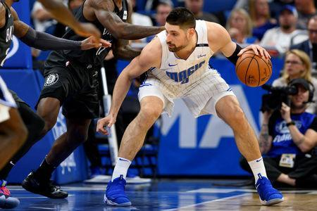 FILE PHOTO: Feb 2, 2019; Orlando, FL, USA; Orlando Magic center Nikola Vucevic (9) dribbles the ball during the second half against the Brooklyn Nets at Amway Center. Mandatory Credit: Douglas DeFelice