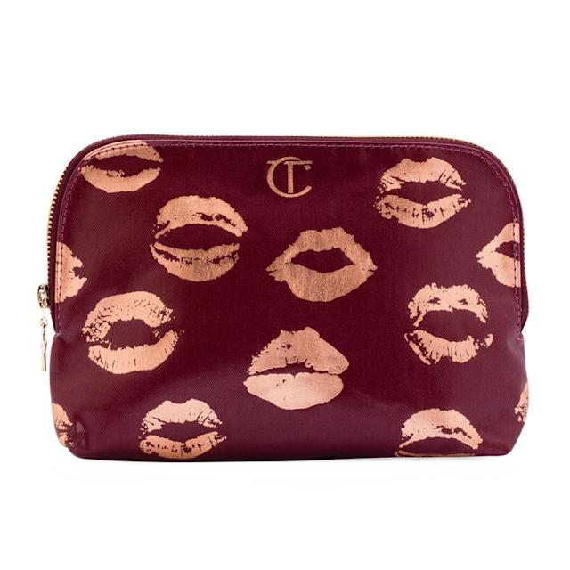 "<p>Who doesn't want a luxe bag with gold-kissed lipsticks all over it? <em>$45, <a href=""http://www.charlottetilbury.com/us/3rd-edition-makeup-bag.html?istCompanyId=df2906b5-23af-4f14-b5ed-2585966c6cfa&istItemId=xilrqawmwa&istBid=tztx&nst=0&gclid=EAIaIQobChMIpcGuntnN1QIVAS1pCh3VxQ26EAQYAyABEgK90vD_BwE&gclsrc=aw.ds"" rel=""nofollow noopener"" target=""_blank"" data-ylk=""slk:charlottetilbury.com"" class=""link rapid-noclick-resp"">charlottetilbury.com</a></em> (Photo: beautylish.com) </p>"