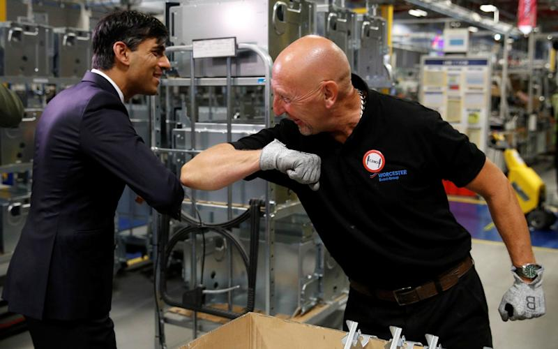 Chancellor of the Exchequer Rishi Sunak greets an employee during his visit to Worcester Bosch factory - Phil Noble/PA