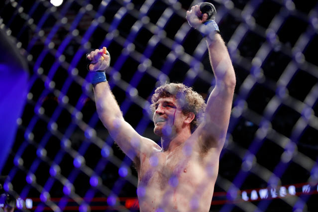 Ben Askren celebrates after defeating Robbie Lawler in a welterweight mixed martial arts bout at UFC 235, Saturday, March 2, 2019, in Las Vegas. (AP Photo/John Locher)