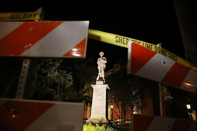<p>Barricades surround the Confederate monument in front of the Hernando County Courthouse to keep possible protesters away from the statue in the midst of a national controversy over whether Confederate symbols should be removed from public display on August 18, 2017 in Brooksville, Fla. (Photo: Joe Raedle/Getty Images) </p>