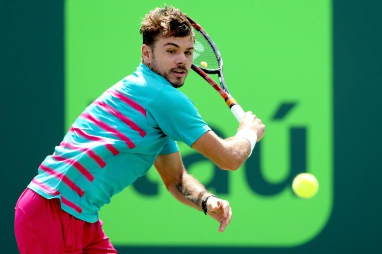 Stan Wawrinka of Switzerland returns a shot to Horacio Zeballos of Argentina during the Miami Open at the Crandon Park Tennis Center on March 25, 2017 in Key Biscayne, Florida