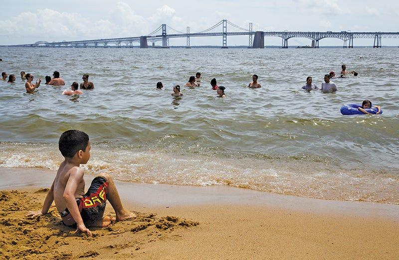 Visitors enjoy the beach at Sandy Point State Park in Anne Arundel County, Maryland.  Steve Droter/Chesapeake Bay Program)