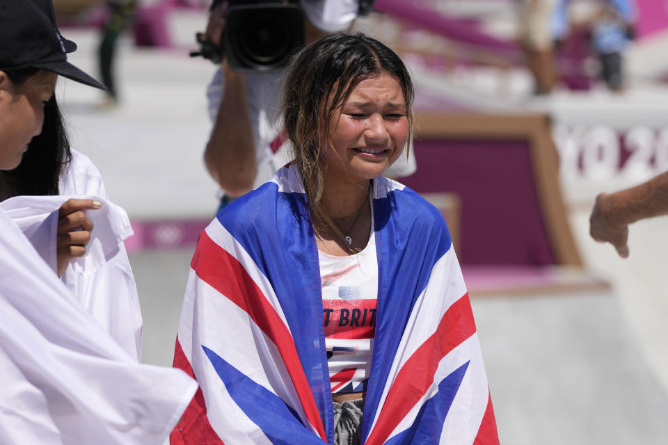 Sky Brown of Britain reacts after winning the bronze in the women's park skateboarding finals at the 2020 Summer Olympics, Wednesday, Aug. 4, 2021, in Tokyo, Japan. (AP Photo/Ben Curtis)