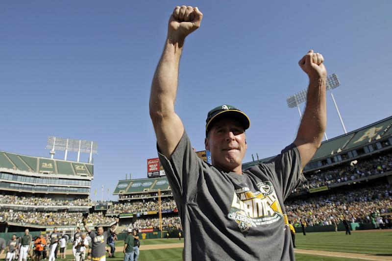 FILE - In this Oct. 3, 2012, file photo, Oakland Athletics manager Bob Melvin celebrates after they clinched the American League West at the end of their 12-5 win over the Texas Rangers in a baseball game in Oakland, Calif. Melvin was voted as the American League Manager of the Year on Tuesday, Nov. 13, 2012. (AP Photo/Ben Margot, File)