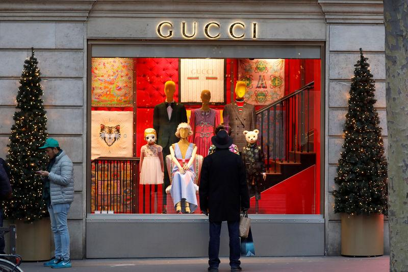 A Gucci sign is seen outside a shop in Paris
