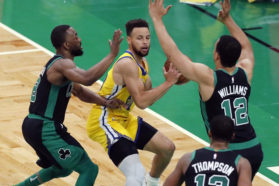 Boston Celtics' Kemba Walker (8) and Grant Williams (12) defend against Golden State Warriors' Stephen Curry, center, during the first half of an NBA basketball game, Saturday, April 17, 2021, in Boston. (AP Photo/Michael Dwyer)