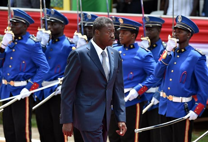 Togo's President Faure Gnassingbe walks past an honour guard in Lome on April 27, 2015 (AFP Photo/Issouf Sanogo)