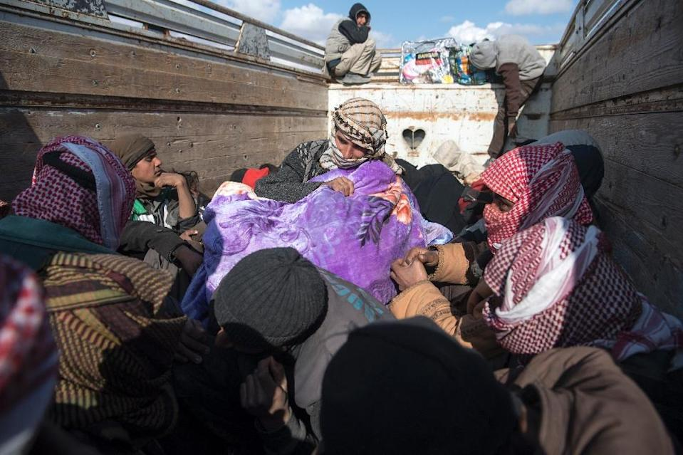 Drivers said a total of 18 foreigners were among dozens of civilians fleeing IS's last pocket in Syria on Monday (AFP Photo/Fadel SENNA)