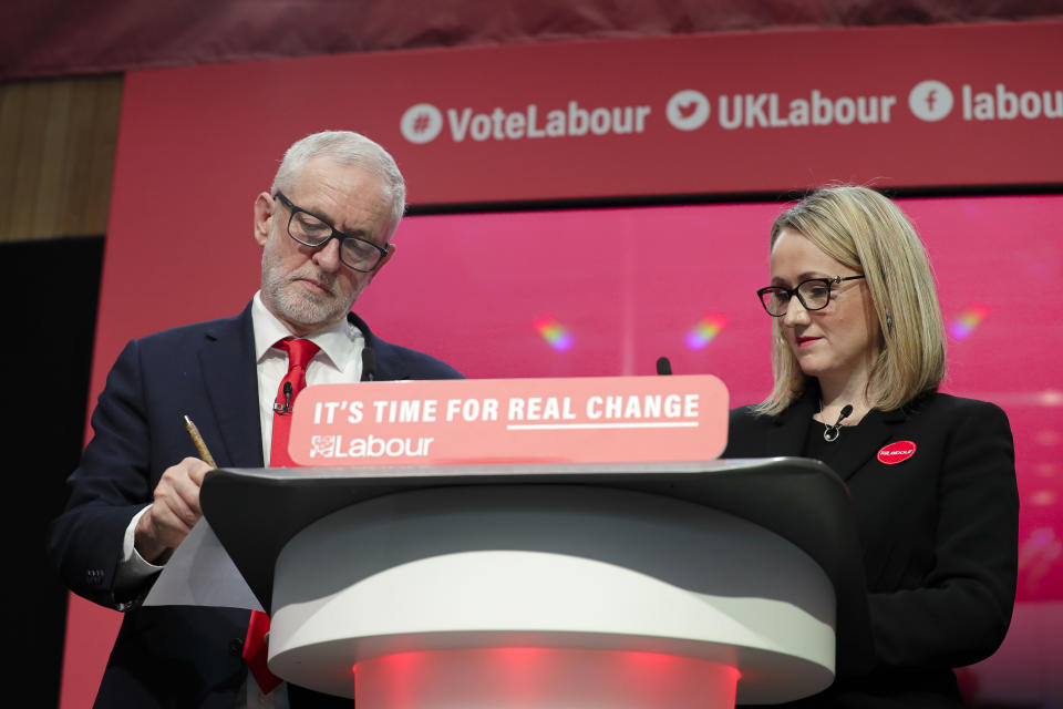 Jeremy Corbyn, Leader of Britain's opposition Labour Party, stands next to Rebecca Long-Bailey on stage at the launch of Labour's General Election manifesto, at Birmingham City University, England, Thursday, Nov. 21, 2019. Britain goes to the polls on Dec. 12. (AP Photo/Kirsty Wigglesworth)