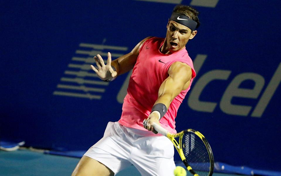 Rafael Nadal hitting a forehand - Rafael Nadal pulls out of US Open over coronavirus fears - REUTERS