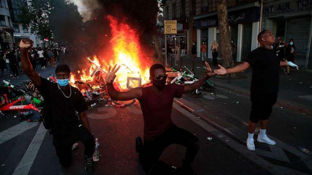 PHOTO: Protesters kneel and react by a burning barricade during a demonstration Tuesday, June 2, 2020 in Paris. (Michel Euler/AP Photo)