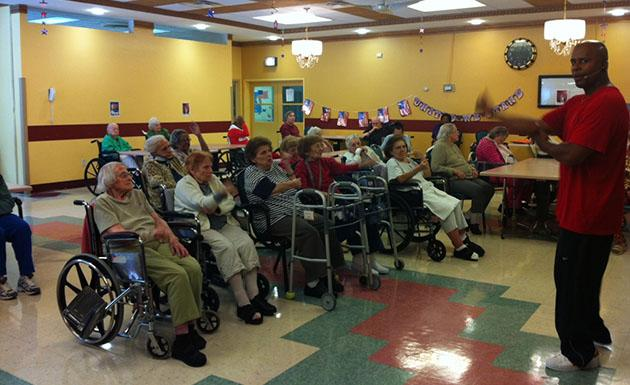Tommy Mickens helps seniors to exercise (photo courtesy Tommy Mickens)